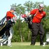 OBA's Josh Barnthouse (right) competes during the OSSAA Class 2A State Golf Tournament at Oakwood Country Club Tuesday, May 13, 2014. (Staff Photo by BONNIE VCULEK)