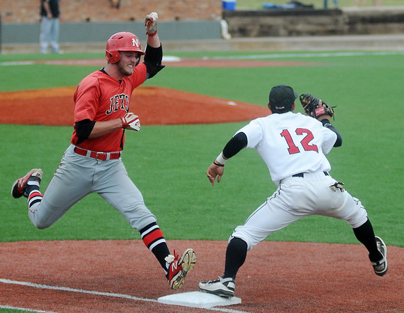 NOC Enid's Korbin Polston beats the throw SECC's Jesus Carrera during the Blackhawks' 3-2 win over the Jets in the NJCAA Division II World Series at David Allen Memorial Ballpark Saturday, May 24, 2014. (Staff Photo by BONNIE VCULEK)