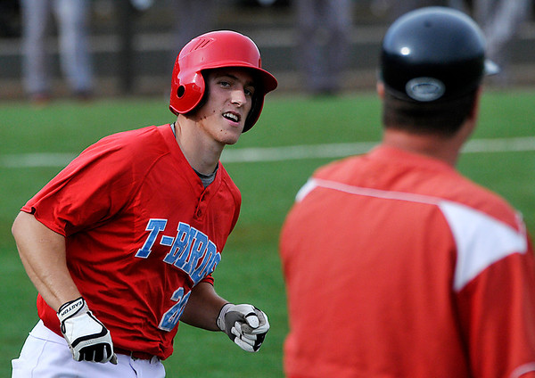 Mesa's Jordan Zimmerman looks at the first base coach after hitting his second home run against SE Iowa during an elimination game Tuesday in the NJCAA DII World Series at David Allen Memorial Ballpark. (Staff Photo by BILLY HEFTON)