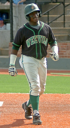 University of Arkansas at Monticello's D'Marco Poindexter smiles after his score gives the Boll Weevils a 2-1 lead over Southern Arkansas University during the Great American Conference Championship game at David Allen Memorial Ballpark Tuesday, May 6, 2014. (Staff Photo by BONNIE VCULEK)