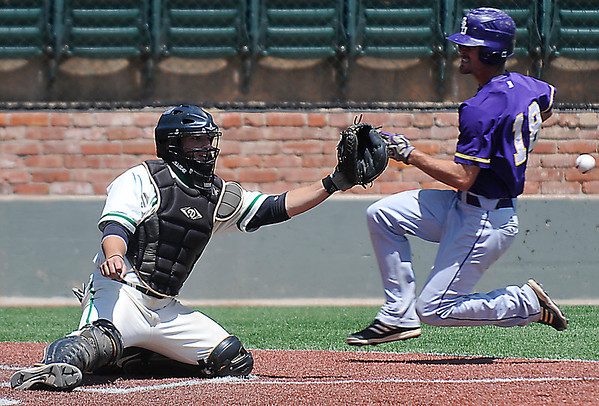 Arkansas-Monticello's Chad Miller waits on the ball as Landon Moore of Ouachita Baptist slides behind to score Monday during the Great American Conference Tournament at David Allen Memorial Ballpark. (Staff Photo by BILLY HEFTON)