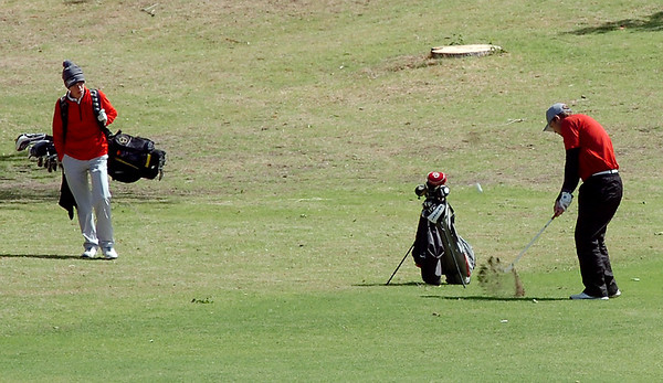 OBA's Josh Barnthouse (right) hits his approach shot onto the No. 11 green at Oakwood Country Club during the OSSAA Class 2A State Golf Tournament Tuesday, May 13, 2014. (Staff Photo by BONNIE VCULEK)