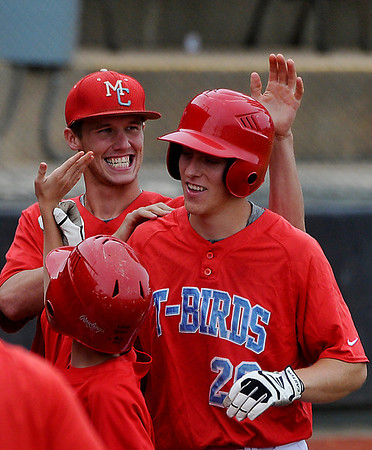 Mesa's Jordan Zimmerman is congratulated by John Havird after hitting his second home run against SE Iowa during an elimination game Tuesday in the NJCAA DII World Series at David Allen Memorial Ballpark. (Staff Photo by BILLY HEFTON)