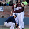 Madison's Luke Yapp looks toward the dugout as Hinds CC's Luke Reynolds stands on third after hitting a 3 run triple against Madison Friday during the Eagles 12-6 win over Madison College to advance to the championship game of the NJCAA DII World Series against Mesa CC at David Allen Memorial Ballpark. (Staff Photo by BILLY HEFTON)