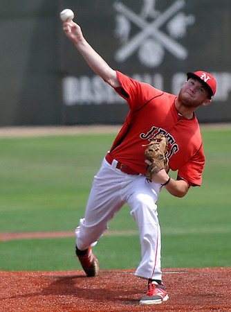 NOC Enid's Jon Chidester delivers a pitch against Hesston during the Plains District Tournament Friday at David Allen Memorial Ballpark. Chidester threw a complete game with 9 strike outs in the Jets 7-3 win. (Staff Photo by BILLY HEFTON)