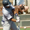SWOSU's Brandon Ruiz connects with a pitch against the University of Arkansas at Monticello during the Great American Conference Championship Tournament at David Allen Memorial Ballpark Saturday, May 3, 2014. (Staff Photo by BONNIE VCULEK)