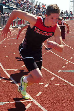OBA's Dylan White begins the Class 3A 3200 relay at Chisholm High School Saturday, May 3, 2014. White, Johnny Volpe, Blake Whitson and Merritt Suenram won the regional relay finals. (Staff Photo by BONNIE VCULEK)