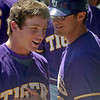 Ouachita Baptist University assistant coach Nick Rountree (right) reassures one of his players during the Great American Conference Tournament at David Allen Memorial Ballpark Saturday, May 3, 2014. (Staff Photo by BONNIE VCULEK)