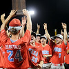 Mesa Community College, from Mesa, AZ, celebrates their NJCAA Division II World Series Championship at David Allen Memorial Ballpark Saturday, May 31, 2014. The Thunderbirds defeated the Hinds Community College Vikings 9-7 in the 11th inning. (Staff Photo by BONNIE VCULEK)