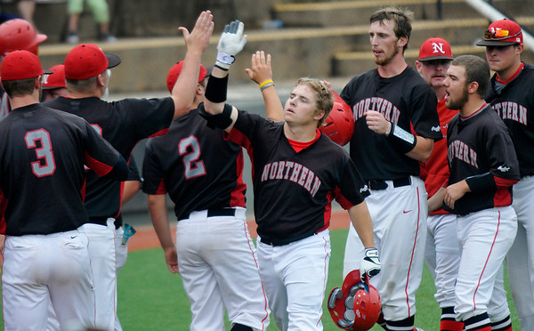 NOC Enid's Russ Colgan id congratulated by team mates after hitting a home run against Westchester CC Sunday during a elimanation game of the NJCAA DII World Series at David Allen Memorial Ballpark. (Staff Photo by BILLY HEFTON)
