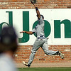 SWOSU's Brandon Ruiz snags a left field fly ball against the University of Arkansas at Monticello during the Great American Conference Championship Tournament at David Allen Memorial Ballpark Saturday, May 3, 2014. (Staff Photo by BONNIE VCULEK)