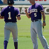 Nick Rountree, an assistant coach for Ouachita Baptist University, greets Justin Weigel at first base during the Great American Conference Tournament at David Allen Memorial Ballpark Saturday, May 3, 2014. (Staff Photo by BONNIE VCULEK)