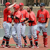NOC Enid Jets celebrate Patrick O'Toole's score during the top of the first inning against the Southeastern Community College Blackhawks during the NJCAA Division II World Series at David Allen Memorial Ballpark Saturday, May 24, 2014. (Staff Photo by BONNIE VCULEK)
