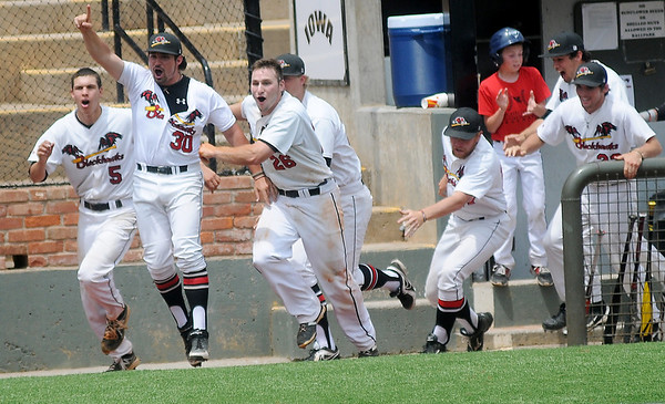 Southeastern Community College Blackhawks sprint onto the field after teammate Dan Ferguson blasts a two-run homerun over the left field wall, giving SECC the 3-2 win over Northern Oklahoma College Enid during the NJCAA Division II World Series at David Allen Memorial Ballpark in Enid, Okla. Saturday, May 24, 2014. (Staff Photo by BONNIE VCULEK)