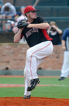 NOC Enid's Austin Hilton delivers a pitch against Westchester CC Sunday during a elimination game of the NJCAA DII World Series at David Allen Memorial Ballpark. (Staff Photo by BILLY HEFTON)