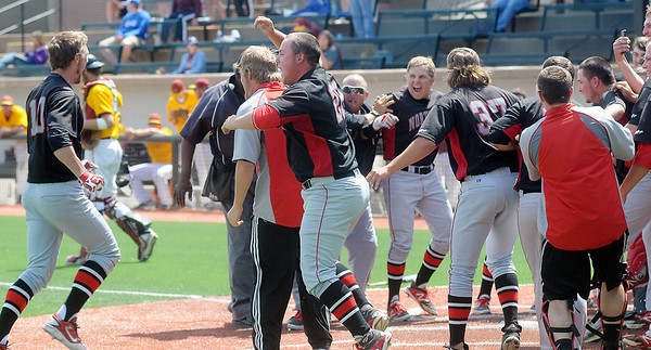 Jerame Littell (left) scores on a walk off homerun in the bottom of the twelfth inning as the NOC Enid Jets celebrate their 1-0 win over the Hesston College Larks and a berth in the NJCAA College World Series in Enid this week. (Staff Photo by BONNIE VCULEK)