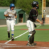SAU's Trevor Rucker heads for home behind UAM's Chad Miller during the Great American Conference championship game at David Allen Memorial Ballpark Tuesday, May 6, 2014. (Staff Photo by BONNIE VCULEK)