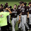 Hinds Community College celebrate their 9-4 win over the Pasco-Hernando State College Conquistadors during the NJCAA Division II World Series at David Allen Memorial Ballpark in Enid, Okla. Tuesday, May 27, 2014. (Staff Photo by BONNIE VCULEK)