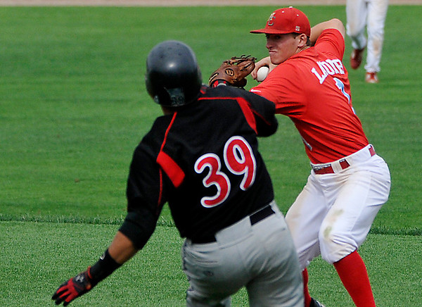 Mesa's Drew Lacomb throws over SE Iowa's Jay Feliciano after a force out at second during an elimination game Tuesday in the NJCAA DII World Series at David Allen Memorial Ballpark. (Staff Photo by BILLY HEFTON)