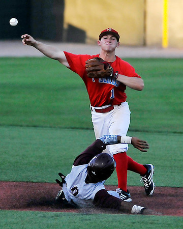 Mesa CC's Drew Lacomb throws over Quade Smith Hinds CC for a double play Thursday during the NJCAA DII World Series at David Allen Memoral Ballpark. (Staff Photo by BILLY HEFTON)