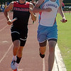 OBA's Johnny Volpe (left) and Chisholm's Bailey Hill concentrate as they compete in the Class 3A 3200 relay during the regional track meet at Chisholm High School Saturday, May 3, 2014. (Staff Photo by BONNIE VCULEK)