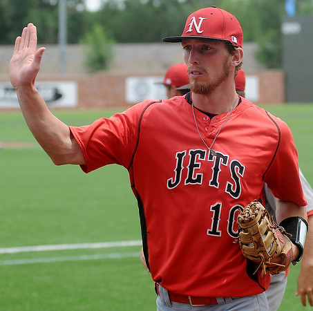 NOC Enid's Jerame Littell returns to the Jets' dug out during the NJCAA Division II World Series at David Allen Memorial Ballpark Saturday, May 24, 2014. (Staff Photo by BONNIE VCULEK)