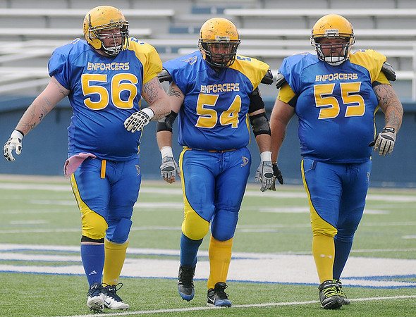 James Blevins (56), Jerome Stonebarger (54) and Jake Skaggs (55) play offensive line for the Enid Enforcers Saturday, May 31, 2014. (Staff Photo by BONNIE VCULEK)