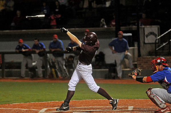The bat flies from the hands of Hinds Community College's Chase Lunceford into the crowd during the NJCAA Div. II World Series at David Allen Memorial Ballpark Saturday, May 24, 2014. (Photo by BONNIE VCULEK)