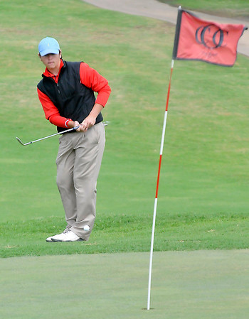 Chisholm's Karsten Brady chips onto the 12th green Monday at Oakwood Country Club during the Class 2A state tournament. (Staff Photo by BILLY HEFTON)