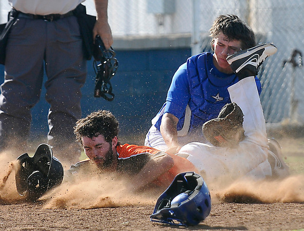 Hennessey's Tabor Johns tags out Zane Word of Cheyenne at home plate during the regional tournament Friday at Hennessey High School. (Staff Photo by BILLY HEFTON)