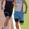 OBA's Blake Whitson strides past Chisholm's Britton Yunker on the 3rd leg of the Class 3A Boys 3200 relay during the regional track meet at Chisholm High School Saturday, May 3, 2014. (Staff Photo by BONNIE VCULEK)