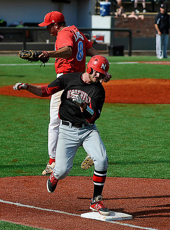 NOC Enid's Korbin Polston avoids the tag from Levi Larmour of Mesa CC Monday during an elimination game in the NJCAA DII World Series at David Allen Memorial Ballpark. (Staff Photo by BILLY HEFTON)