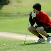OBA's Andy Eaton aligns his putt during the OSSAA Class 2A State Golf Tournament at Oakwood Country Club Tuesday, May 13, 2014. (Staff Photo by BONNIE VCULEK)