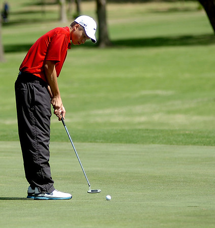OBA's Thomas Friesen putts on the No. 11 green at Oakwood Country Club during the OSSAA Class 2A State Golf Tournament Tuesday, May 13, 2014. (Staff Photo by BONNIE VCULEK)