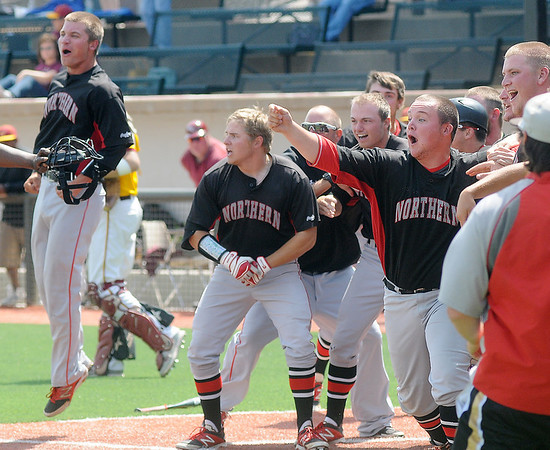 The Northern Oklahoma College Enid Jets celebrate Jerame Littell's walk off homerun in the bottom of the twelfth inning as Littell rounds the bases at David Allen Memorial Ballpark Saturday, May 17, 2014. NOC Enid's 1-0 win over Hesston College punched the Jets ticket to the NJCAA College World Series next week in Enid. (Staff Photo by BONNIE VCULEK)