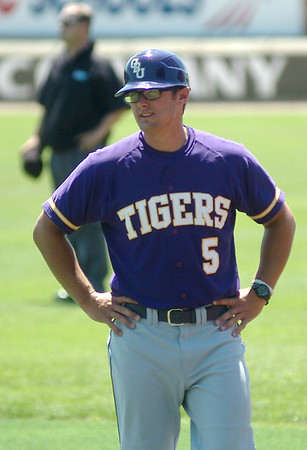 Nick Rountree, a Ouachita Baptist University assistant coach, pauses near the Tigers dug out during the Great American Conference Tournament at David Allen Memorial Ballpark Saturday, May 3, 2014. (Staff Photo by BONNIE VCULEK)