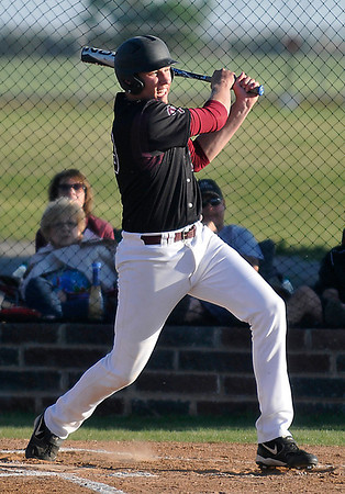 Pioneer's Colby Koontz hits a double against Drummond Friday during the regional tournament at Pioneer High School. (Staff Photo by BILLY HEFTON)
