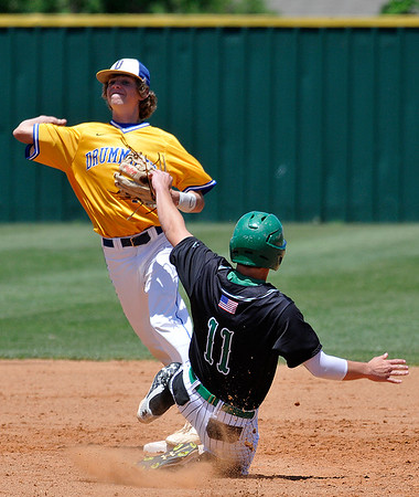 Drummond's Seth Gray throws over Leedey's Colton Hunter to complete a doublepolay during the quarterfinals of the class B state tournament Thursday May 5, 2016 at Edmond Santa Fe High School. (Billy Hefton / Enid News & Eagle)