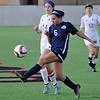 Enid's Alicia Chain kicks the ball away from Union's Taylor Malham during the first round of state playoffs at the Union soccer stadium in Tulsa Tuesday May 3, 2016. (Billy Hefton / Enid News & Eagle)