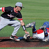 NOC Enid's justin Brown tags out Carl ALbert's Pedro Diaz Thursday May 12, 2016 during the Region 2 District tournament at David Allen Ballpark. (Billy Hefton / Enid News & Eagle)