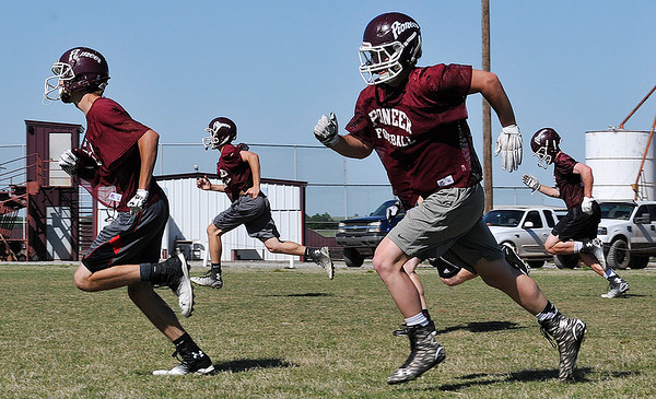 Players from Pioneer High School run through drills during spring football practice Tuesday May 10, 2016. (Billy Hefton / Enid News & Eagle)