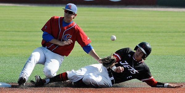 NOC Enid's Zach Lewis slides into second as the ball bounces away from Carl Albert CC's Cody Robinson Saturday May 14, 2016 during the Region 2 District tournament at David Allen Ballpark. (Billy Hefton / Enid News & Eagle)