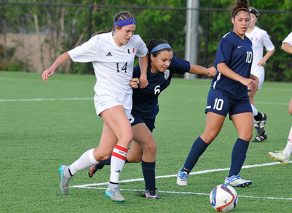 Enid's Alicia Chain (6) and Hudsyn Childs (10) defends Union's Taylor Malham during the first round of state playoffs at the Union soccer stadium in Tulsa Tuesday May 3, 2016. (Billy Hefton / Enid News & Eagle)