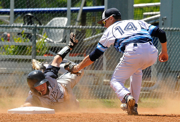 Enid's Gage McNeil tags out Edmond North's Mason Carrier at third during the regional tournament Wednesday May 4, 2016 at Deer Creek High School. (Billy Hefton / Enid News & Eagle)