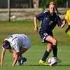 Enid's Kylee Vestal gets away from Union's Taylor Malham during the first round of state playoffs at the Union soccer stadium in Tulsa Tuesday May 3, 2016. (Billy Hefton / Enid News & Eagle)