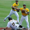 Western Oklahoma's Frankely Gonzales backs up Raul Mercado as he throws over Monroe CC's Alex Saville to complete a double play Tuesday May 31, 2016 in the NJCAA DII World Series at David Allen Ballpark. (Billy Hefton / Enid News & Eagle)