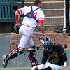 Sinclair catcher, Hunter Losekamp, runs off the field after tagging out Monroe CC's Luke Brust at home plate during the NJCAA DII World Series at David Allen Ballpark in Enid Sunday May 29, 2016. (Billy Hefton / Enid News & Eagle)