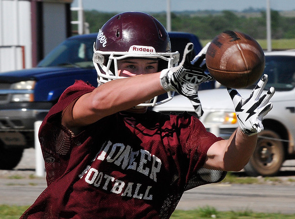 Pioneer's Cody McVey catches a pass during spring football practice Tuesday May 10, 2016. (Billy Hefton / Enid News & Eagle)