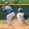 Enid's Mason Skrimager looks to first after forcing out Edmond North's Clayton Peterson during the regional tournament Wednesday May 4, 2016 at Deer Creek High School. (Billy Hefton / Enid News & Eagle)