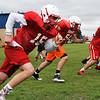 Members of the Chisholm High School football team go through drills during spring practice Tuesday May 17, 2016. (Billy Hefton / Enid News & Eagle)